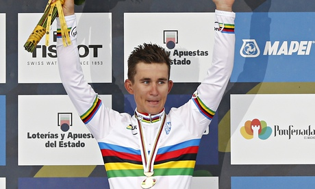 Poland's Michal Kwiatkowski celebrates winning the Road Cycling World Championships in Spain. Photo: Daniel Ochoa De Olza / AP