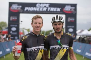 South Africans Matthys Beukes (left) and Gert Heyns of SCOTT Factory Racing LCB 2 pose for a winner's shot after Stage 1 of the Cape Pioneer Trek from Mossel Bay to George, South Africa on Monday. Photo credit: Zoon Cronje/Nikon