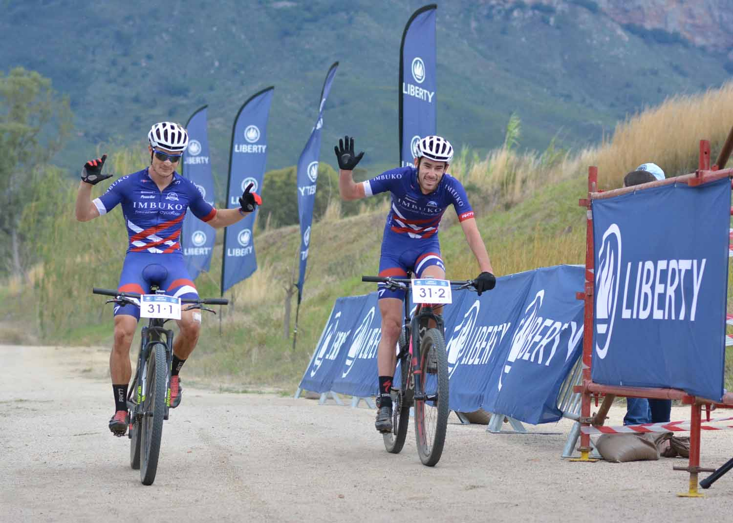 Chris Wolhuter (left) and Craig Boyes of Imbuko-Freewheel Cycology win the overall title of the 2016 Liberty Winelands MTB Encounter on Saturday. Photo: Full Stop Communications