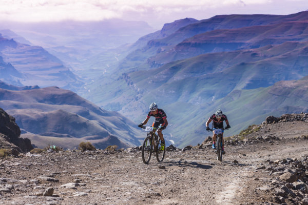 Reinhard Zellhuber and Marc Fourie climbing to the top of the podium on Saturday's second stage of the 2016 Fedauto Sani Dragon. Photo: Anthony Grote