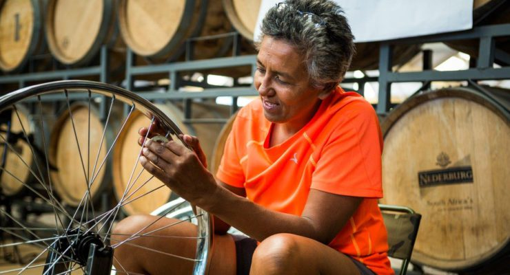 Beverly Roode working on a bicycle
