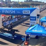 Daryl Impey crosses the line