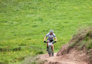 An image of one of the Drak Descent riders making his way up a hill on stage one of the 2018 event.