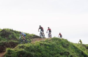 Riders making their way down a hill on stage one of the 2018 Drak Descent.