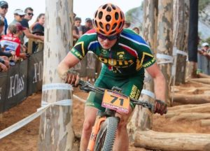 An image of a South African mountain biker in action at the first leg of the 2018 UCI Mountain Bike World Cup.