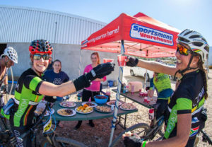 Riders at waterpoint on stage one Gravel & Grape Extreme 3-day