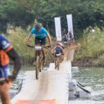 Riders crossing a wavy bridge during the sani2c Race. Photo: Anthony Grote
