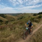 A mountain biker enjoys beautiful scenery on day three of sani2c Adventure