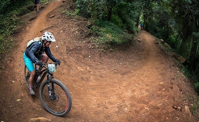 A rider takes a corner on day two of sani2c Adventure