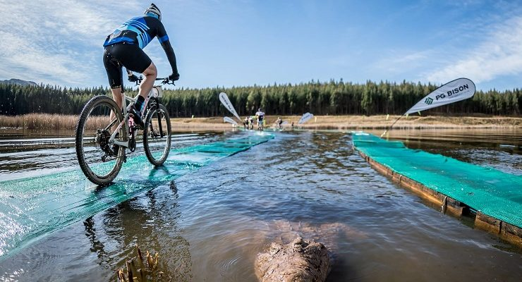 A crocodile pops up at the water bridge on day one of sani2c Adventure