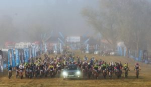Riders are led out of the start on day one of the sani2c Race