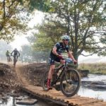 Matthew Beers crosses a wooden bridge on day one of the sani2c Race