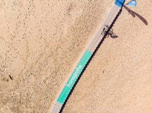 Crossing a bridge over beach sand on the final day of the sani2c Trail.
