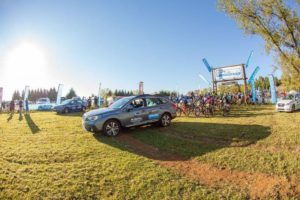 A vehicle leads the riders out at the start of day one of sani2c Trail