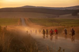 The sun rises as mountain bikers tackle day two of sani2c Trail