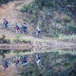 Riders laboring up a climb on the riverside during stage two of the Greyt Escape. Photo: Oakpics.com