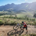 A tired rider pushing his bike up a climb with a great view during stage two of the Greyt Escape. Photo: Oakpics.com