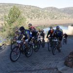A group of riders labouring up a paved climb during stage three of the Waterberg MTB Encounter. Photo: Gerrie Kriel / Twin Productions SA