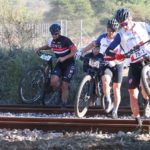Leading riders carrying their bikes across a train track during stage three of the Waterberg MTB Encounter. Photo: Gerrie Kriel / Twin Productions SA