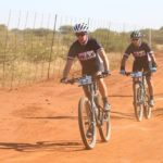 Riders taking on a dusty and flat gravel road during stage three of the Waterberg MTB Encounter. Photo: Gerrie Kriel / Twin Productions SA