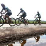 A group of riders lined up beside a wetland during the Around the Pot 100 Miler. Photo: Oakpics