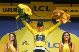Team Sky's Geraint Thomas celebrates after stage 19 of the Tour de France