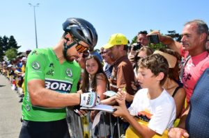 Peter Sagan interacts with fans on stage four of the Tour de France.