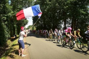 A fan cheers on riders during stage two of the Tour de France