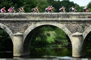 Riders crossing a bridge on stage four of the Tour de France