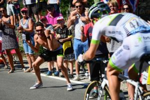 Fans cheer on riders during stage six of the Tour de France