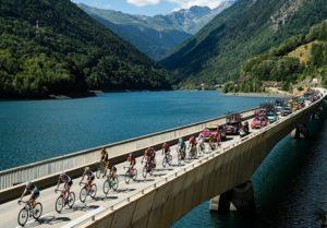 The peloton cross a bridge on stage 12 of the Tour de France