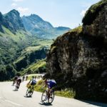 The peloton pass beautiful scenery during stage 11 of the Tour de France