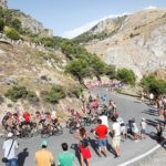 A group of cyclists take a corner during a Vuelta a Espana stage.