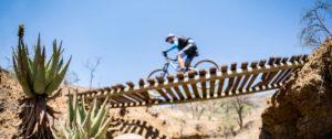 Berg & Bush Descent stage one rider crosses brigde