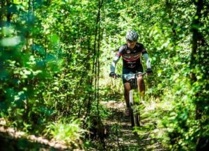 A rider moving through a dense forest section in stage two of the Berg and Bush 'Descent'. Photo: Tobias Ginsberg