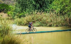A rider crossing a suspension bridge on the Tugela River during stage two of the Berg and Bush 'Descent'. Photo: Tobias Ginsberg