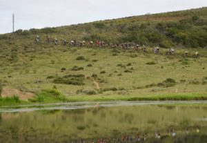 A wide-pan shot of riders ascending a climb during stage two of the Cape Pioneer Trek. Photo: Carli Smith