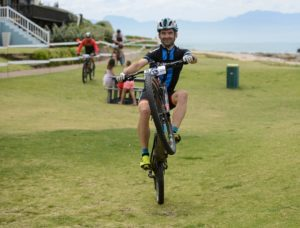 A rider performing a wheelie during the prologue of the Cape Pioneer Trek. Photo: Zoon Cronje