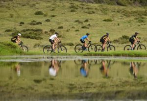Riders moving alongside a river during stage two of the Cape Pioneer Trek. Photo: Carli Smith
