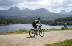 A rider spoiled with a splendid view of a lake and the mountains during stage three of the Cape Pioneer Trek. Photo: Carli Smith