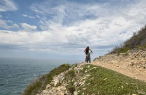 A rider on the edge of a climb, spoiled with a spectacular view, during the prologue of the Cape Pioneer Trek. Photo: Zoon Cronje