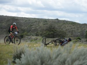 A rider on the ground after taking a fall during stage one of the Cape Pioneer Trek. Photo: Marike Cronje