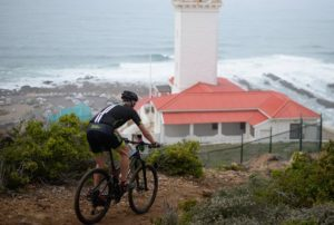 A rider spoiled with a great view of the ocean and a lighthouse during the prologue of the Cape Pioneer Trek. Photo: Zoon Cronje