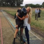 Gert Fouche, pictured being consoled afterwards, has told of the mental and physical pain he endured when he broke the South African hour record at Hector Norris Park in Johannesburg last week. Photo: Facebook/Performance Through Science Coaching