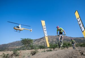 Winning men's pair Matthys Beukes and Philip Buys taking on a ramp during stage three of the Berg and Bush 'Descent'. Photo: Em Gatland/Nikon