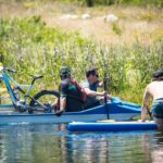 Riders taking it easy in a raft during the Origin of Trails. Photo: David Tarpey