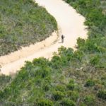 A wonderful aerial shot of riders moving along a wide and open gravel section at the Origin of Trails. Photo: David Tarpey