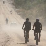 Riders moving along a dusty gravel road during the Desert Dash. Photo: Gondwana Collection Namibia