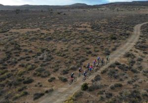 A spectacular aerial image of riders bunch up and moving through the Karoo at the Attakwas Extreme. Photo: ZC Marketing Consulting