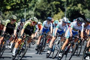 A bunch of cyclists take a corner during the Women's Tour Down Under